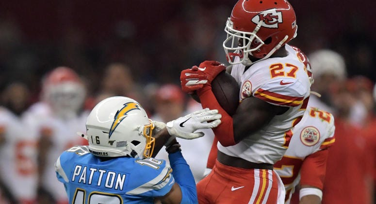 Nov 18, 2019; Mexico City, MEX; Kansas City Chiefs defensive back Rashad Fenton (27) intercepts a pass intended for Los Angeles Chargers wide receiver Andre Patton (16) in the fourth quarter during an NFL International Series game at Estadio Azteca. The C