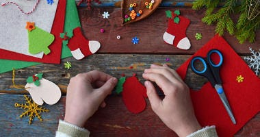 Child making Christmas craft