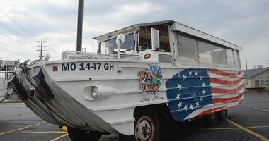 A duck boat sits on a parking lot