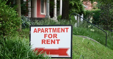 "A sign in a front yard reads, ""Apartment for Rent"""