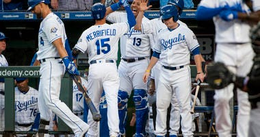 Sep 10, 2018; Kansas City, MO, USA; Kansas City Royals catcher Salvador Perez (13) celebrates with Kansas City Royals second baseman Whit Merrifield (15) after hitting a home run against the Chicago White Sox in the first inning at Kauffman Stadium.