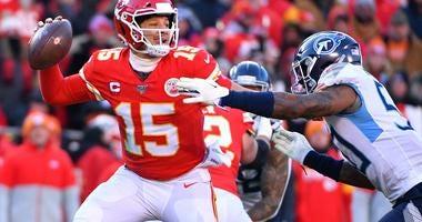 Jan 19, 2020; Kansas City, Missouri, USA; Kansas City Chiefs quarterback Patrick Mahomes (15) throws a pass against Tennessee Titans linebacker Derick Roberson (50) during the first half in the AFC Championship Game at Arrowhead Stadium. Mandatory Credit: