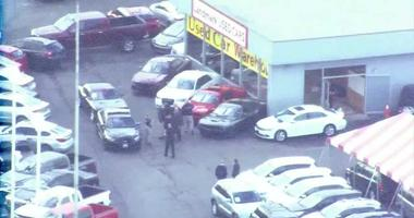 helicopter view of car dealership in Independence, MO after shooting