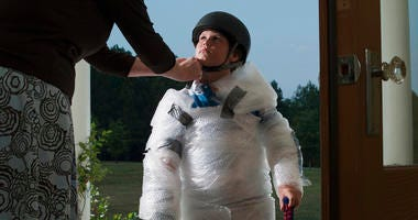 Mother wraps child in bubblewrap to protect him from the world