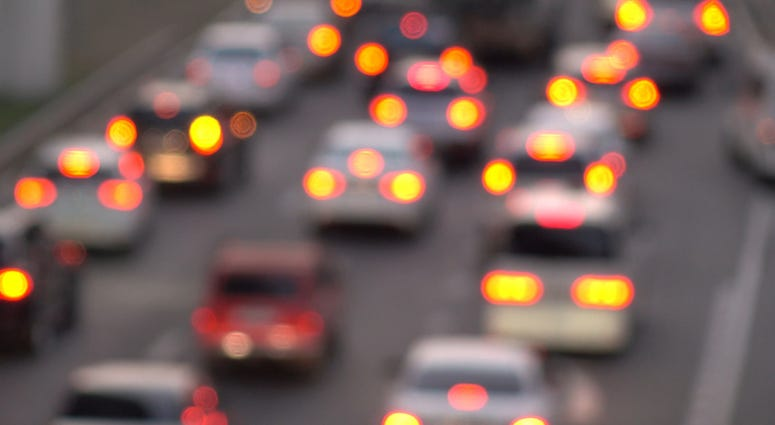 cars seen from behind in a traffic jam