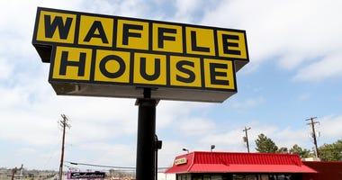 The exterior and sign of a Waffle House restaurant in Colorado. File photo