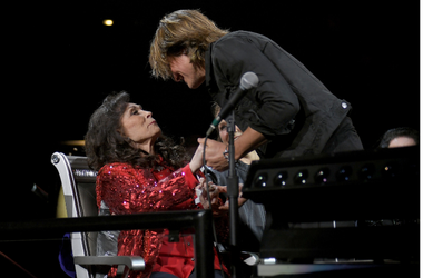 Keith Urban greets Loretta Lynn during Loretta Lynn: An All-Star Birthday Celebration Concert at Bridgestone Arena on April 1, 2019 in Nashville, Tennessee
