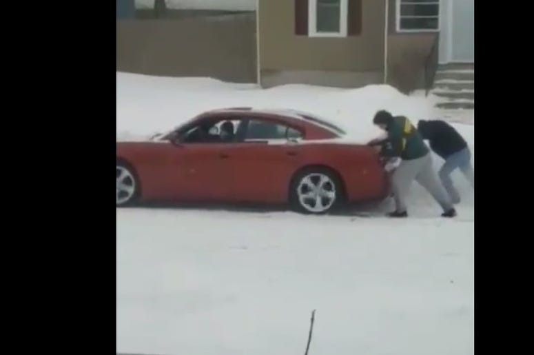 couple stuck in snow