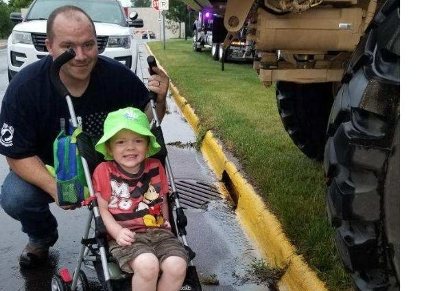 toddler drives tractor to county fair