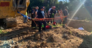 St. Charles firefighters rescue man from trench