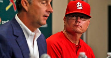 St. Louis Cardinals president of baseball operations John Mozeliak, left, speaks about the firing of Cardinals manager Mike Matheny as interim manager Mike Shildt, right, listens.