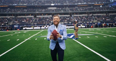 UFC fighter Conor McGregor reacts on the sideline before an NFL football game