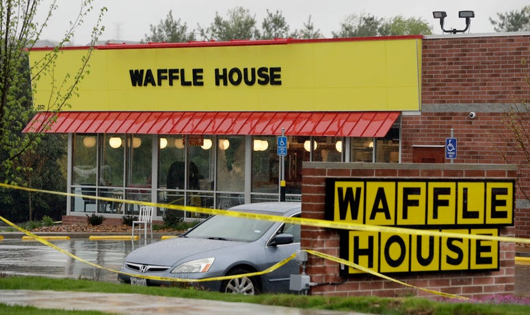 Police tape blocks off a Waffle House restaurant Sunday, April 22, 2018, in Nashville, Tenn. At least four people died after a gunman opened fire at the restaurant early Sunday.