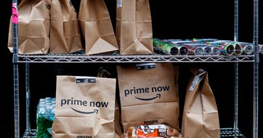 Amazon Prime Now bags are ready for delivery, at the Amazon warehouse in New York.