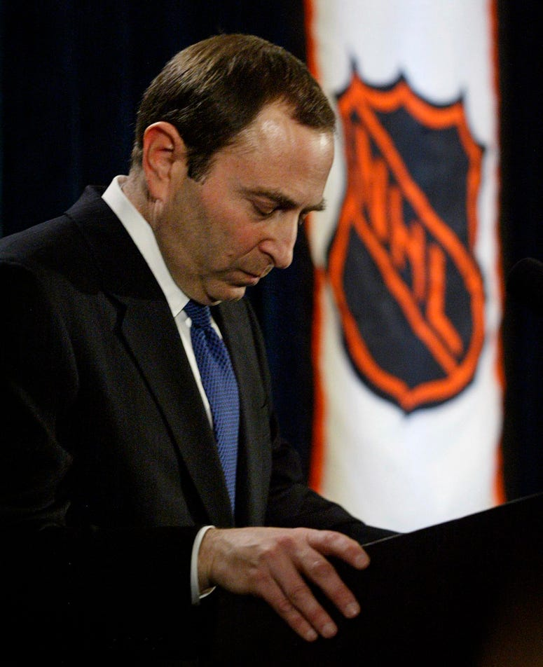 2005, file photo, NHL commissioner Gary Bettman listens to a question after announcing the cancellation of the current hockey season.