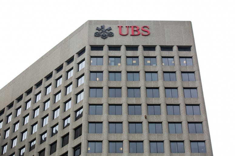 A raccoon scales the side of the UBS Tower in downtown St. Paul, Minn., on Tuesday, June 12, 2018.