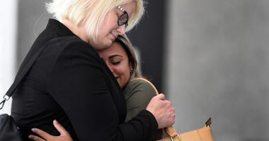 Sirley Silveira Paixao, right, an immigrant from Brazil seeking asylum, hugs her Chicago based attorney Britt Miller, after a hearing where a federal judge ordered the release of her 10-year-old son Diego from immigration detention, Thursday, July 5, 2018