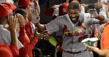 St. Louis Cardinals' Dexter Fowler celebrates in the dugout