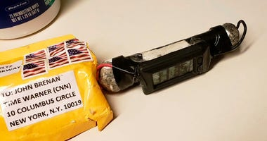 This image obtained Wednesday, Oct. 24, 2018, and provided by ABC News shows a package addressed to former CIA head John Brennan and an explosive device that was sent to CNN's New York office.