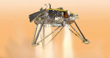 illustration of NASA's InSight lander about to land on the surface of Mars.