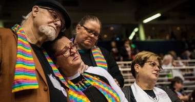 Ed Rowe, left, Rebecca Wilson, Robin Hager and Jill Zundel, react to the defeat of a proposal that would allow LGBT clergy and same-sex marriage within the United Methodist Church at the denomination's 2019 Special Session of the General Conference in St.