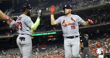 St. Louis Cardinals' Matt Adams (15) celebrates his home run with Marcell Ozuna (23) during the fifth inning of a baseball game against the Washington Nationals, Wednesday, Sept. 5, 2018, in Washington.
