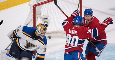 Montreal Canadiens' Brendan Gallagher (11) reacts with teammate Tomas Tatar after scoring against St. Louis Blues goaltender Jake Allen