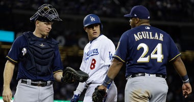 Milwaukee Brewers' Jesus Aguilar and Los Angeles Dodgers' Manny Machado have words