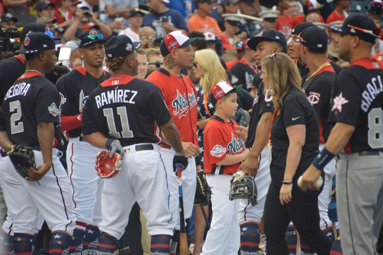Yadier Molina with other players on the field before the Home Run Derby at the 2018 All-Star Game