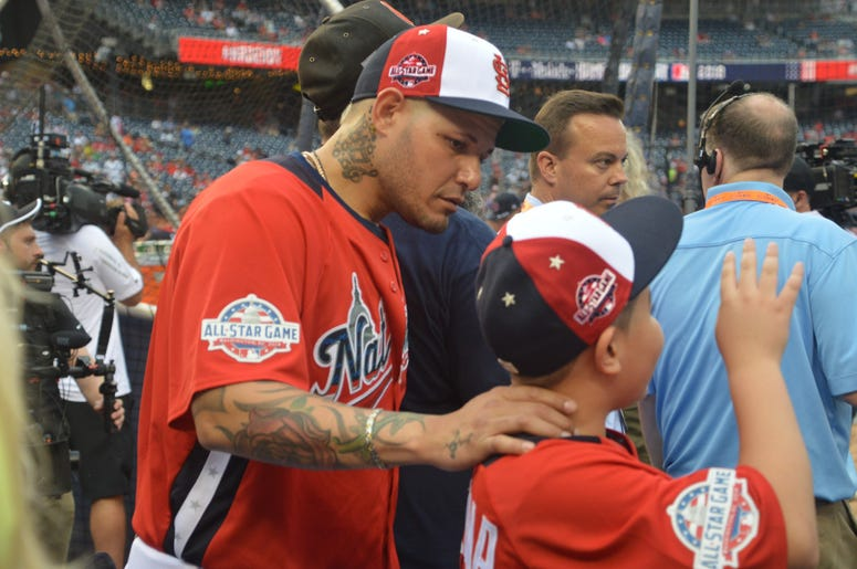 Yadier Molina with his son on the field at the Home Run Derby, before 2018 All-Star Game