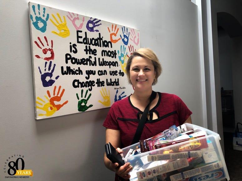 Little Bit Foundation donation Debbie Monterrey American Eagle Credit Union person hygiene drive