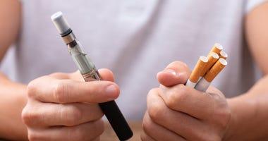 vape pen and cigarettes