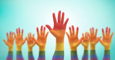 rainbow hands raised