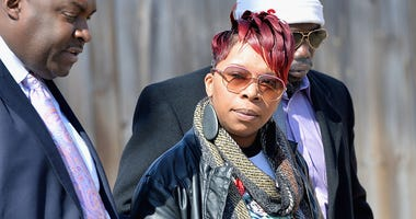 Lesley McSpadden, mother of slain teenager Michael Brown Jr., exits after a press conference at the Greater St. Mark Missionary Baptist Church on March 5, 2015 in Dellwood, Missouri.