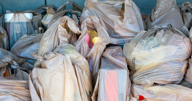 plastic bags full of groceries