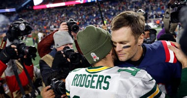 Green Bay Packers quarterback Aaron Rodgers (12) greets New England Patriots quarterback Tom Brady