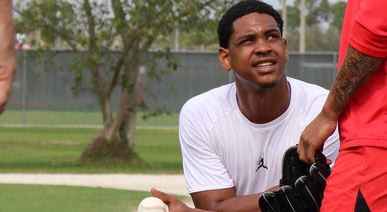 Pitcher Alex Reyes watches his teammates' throw bullpens during Cardinals spring training