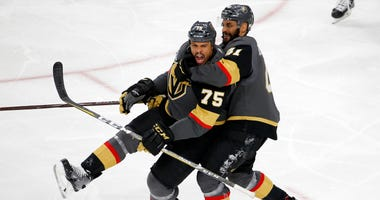 Vegas Golden Knights right wing Ryan Reaves, left, celebrates his goal with left wing Pierre-Edouard Bellemare