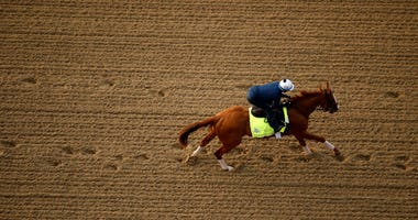 Kentucky Derby entrant Good Magic runs during a morning workout at Churchill Downs Wednesday, May 2, 2018, in Louisville, Ky.