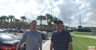 KMOX's Chris Hrabe walks with Paul DeJong in the Cardinals spring training parking lot.