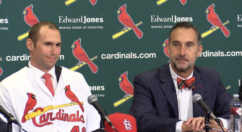 Paul Goldschmidt and John Mozeliak at the Cardinals press conference.