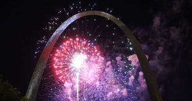 Fireworks illuminate the Gateway Arch during the last night of Fair St. Louis in St. Louis on July 7, 2018.