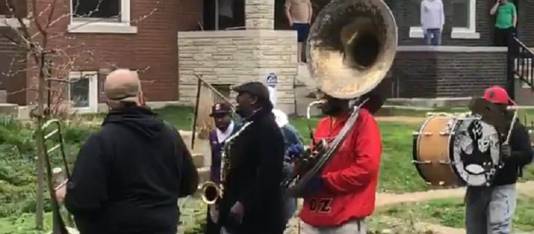 WATCH: Walking St. Louis band performs down neighborhood streets