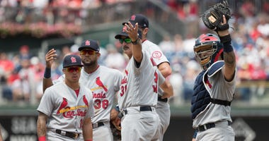 St. Louis Cardinals pitching coach Mike Maddux (31) calls for the trainer