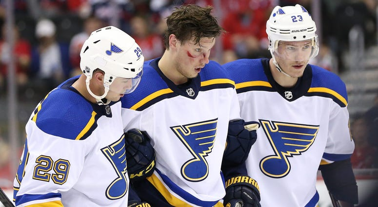 St. Louis Blues center Oskar Sundqvist (70) is helped off the ice after a check by Washington Capitals right wing Tom Wilson