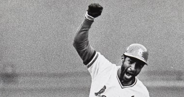 Ozzie Smith rounds third base after hitting a walk-off home run in Game 5 of the 1985 NLCS.