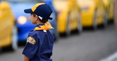 A boy scout looks on as drivers are introduced during the Honda Indy Grand Prix of Alabama at Barber Motorsports Park.