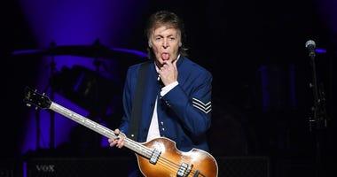 Paul McCartney sticks his tongue out