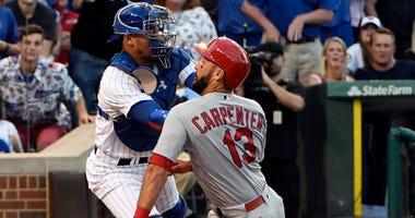 Chicago Cubs catcher Willson Contreras (40) tags out St. Louis Cardinals first baseman Matt Carpenter