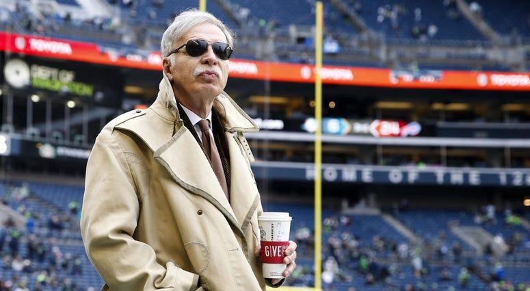 Los Angeles Rams owner Stan Kroenke watches pregame warmups against the Seattle Seahawks at CenturyLink Field.